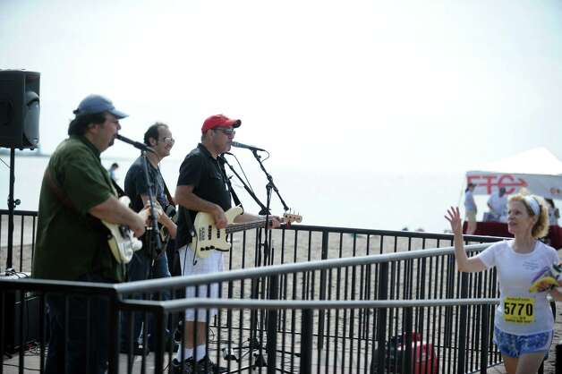 The band Fairly Famous performs during the 32nd Stratton Faxon 5K Saturday, June 23, 2012 at Jennings Beach in Fairfield, Conn. Photo: Autumn Driscoll / Connecticut Post
