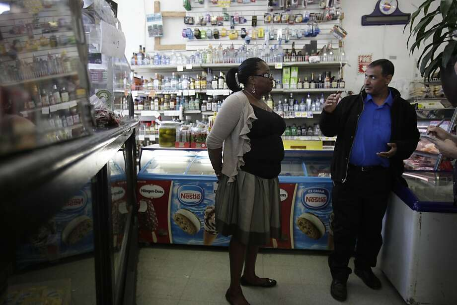 """Yahya """"Mike"""" Korin (right), owner Northside Supermarket, talks with Theresa Anderson (left), Oakland Green Party Candidate, At-Large City Council Seat, at his store on Friday, June 8, 2012 in Oakland, Calif. Photo: Lea Suzuki, The Chronicle"""