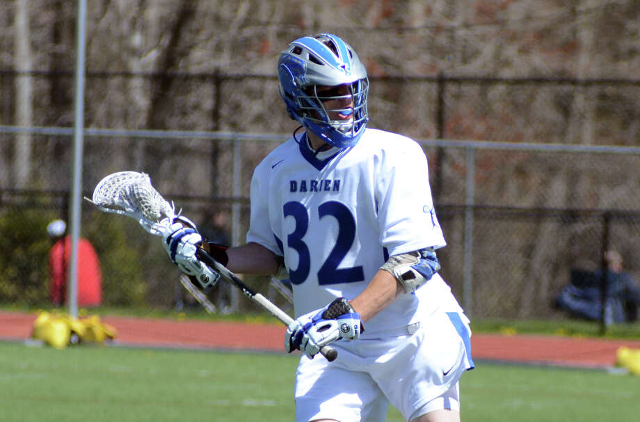 Darien's Henry West (32) takes a shot during the boys lacrosse game against Staples at Darien High School on Saturday, Apr. 7, 2012. Photo: Amy Mortensen / Stamford Advocate Freelance