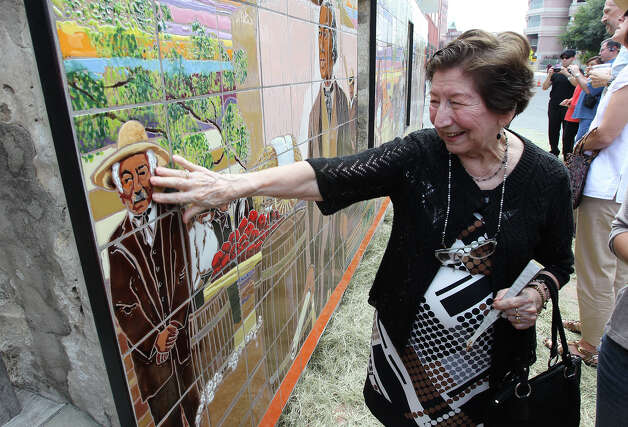 Patrina Rodriguez brushes her hand against a mural which has the likeness of her husband, Ruben, after the mural's unveiling ceremony at Casa Navarro State Historic Site on Saturday, June 23, 2012. The mural was created by Jesse Trevino and his wife Elizabeth Rodriguez. Elizabeth Rodriguez is the niece to Patrina and Ruben Rodriguez and used the likeness of her uncle as well as other family members to depict the people in the mural. The Texas Historical Commission, Friends of Casa Navarro and the Cortez Family unveiled the mural which was created by artists Trevino and Rodriguez in honor of Jose Antonio Navarro. The mural depicts life in historic San Antonio. Ruben Rodriguez had passed away last year. Photo: Kin Man Hui, Express-News / ©2012 San Antonio Express-News