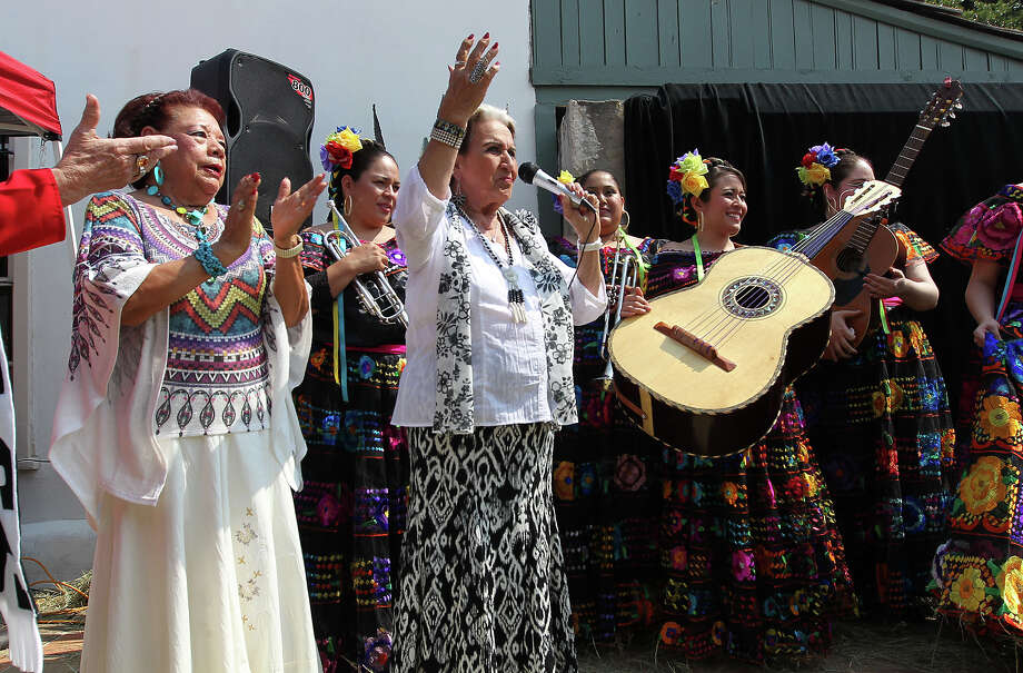 Singers Rita Vidaurri (center) and Beatrice Llamas perform a ballad to the delight of the crowd as the Texas Historical Commission, Friends of Casa Navarro and the Cortez Family unveil a mural created by artist Jesse Trevino and his wife Elizabeth Rodriguez at the Casa Navarro State Historic Site on Saturday, June 23, 2012. Photo: Kin Man Hui, Express-News / ©2012 San Antonio Express-News