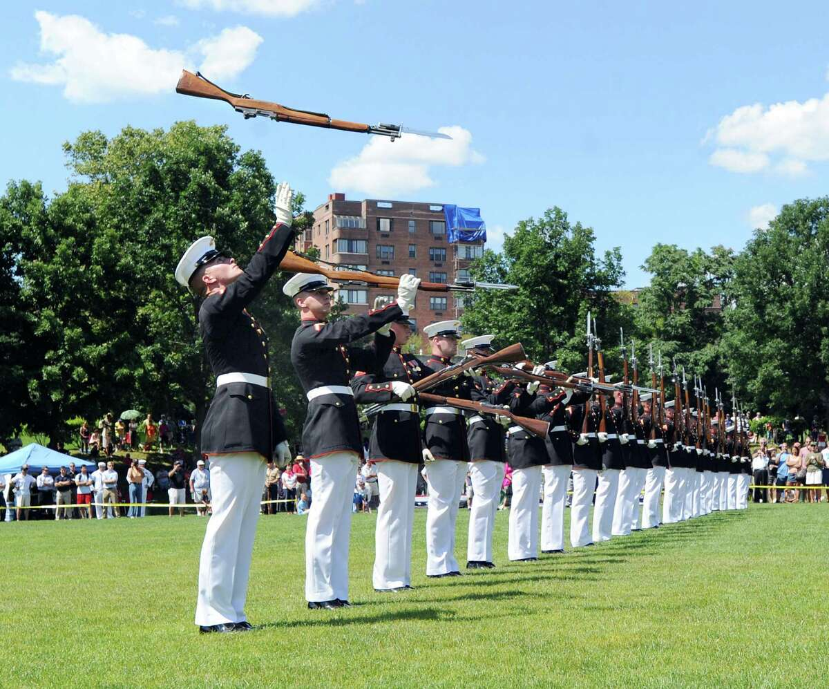 The U.S. Marine Corps Silent Drill Platoon performs during the Salute to Veterans ceremony at Havemeyer Field in Greenwich, Saturday afternoon, June 23, 2012.