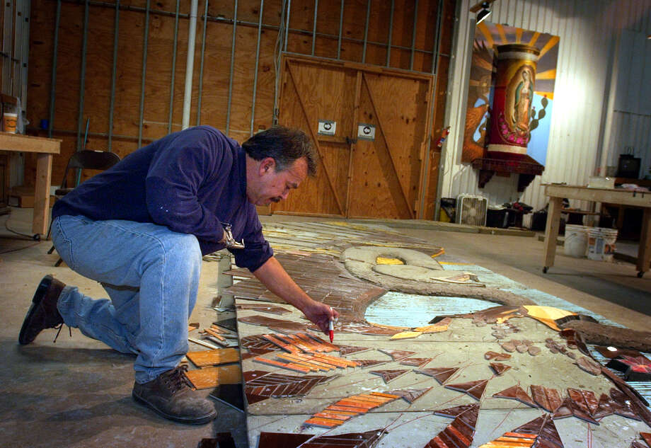 "San Antonio artist Jesse Trevino works on his newest work titled ""Veladora"", in a warehouse at San Antonio Press,  Nov. 25, 2003.  Bob Owen/Express-News Photo: BOB OWEN, Express-News / SAN ANTONIO EXPRESS-NEWS"
