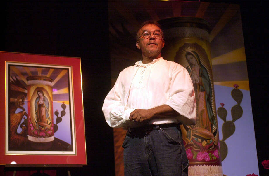 Artist Jesse Trevino unveils a fine print of the Veladora mural project Wednesday, May 22, 2002 at the Guadalupe Theater in San Antonio, Texas. The artwork is being put up as a mural on Guadalupe Ave. Alicia Wagner Calzada/ Special to the Express-News Photo: Express-News