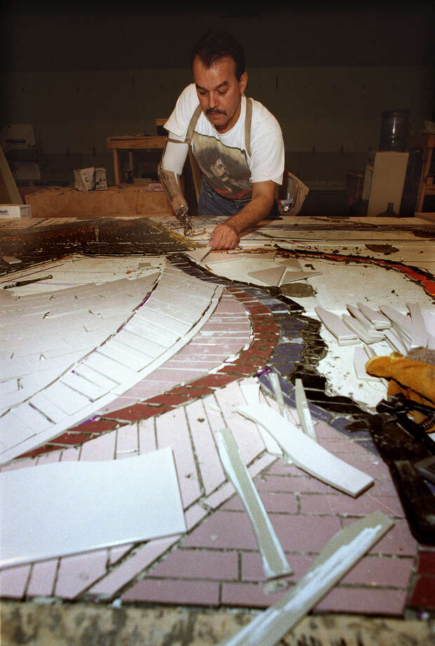 Jesse Trevino works on cutting tiles for the mural that will be at Santa Rosa Children's Hospital. PHOTO BY MORRIS GOEN/STAFF 8/12/1997 Photo: Express-News