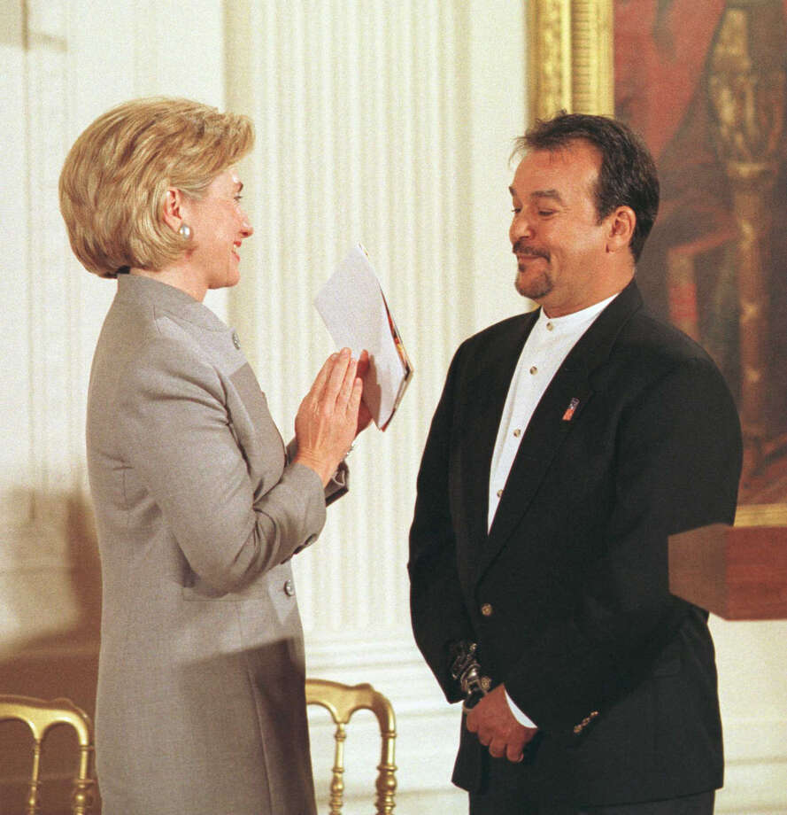 Artist Jesse Travino (right) receives a thank you from First Lady Hillary Rodham Clinton (left) after addressing the 1998 Coming up Taller Awards, October 07, 1998, in the East Room of the White House in Washington, DC.  Travino was invited to speak in recognition of his work bring art to disadvantaged youth through the Urban saARTS program in San Antonio.     Robert Visser/Photopress Washington 1998 Photo: Express-News