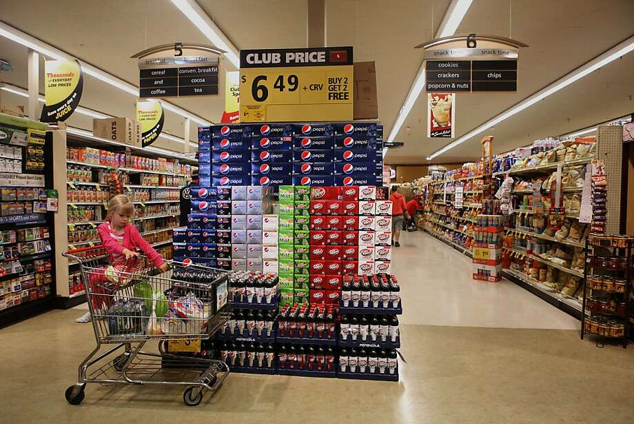 Cases of soda get a prominent display at a Safeway grocery in San Francisco. While other cities are considering limits on soda sales, San Francisco is focusing on education efforts for now. Photo: Liz Hafalia, The Chronicle