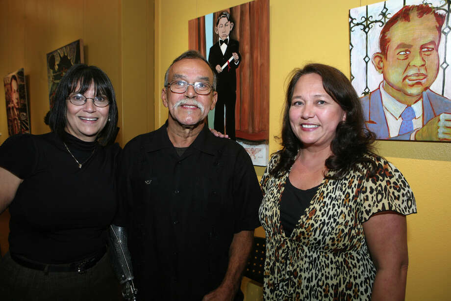 "Mary ""Magda"" Pena Terry (Daughter to Albert Pena, Jr., Artist), Jesse Trevino (Co Curator, ene on N) and Olga Pena Wurts (Daughter to Albert) were at the Hispanic Heritage Month Opening - Portrait of Xicano Conscience (The Great Judge Albert Pena, Jr.) on 9/15/2009 at the SA Central Library. Leland A. Outz/For the Express-News Photo: LELAND A. OUTZ, Express-News / SAN ANTONIO EXPRESS-NEWS"