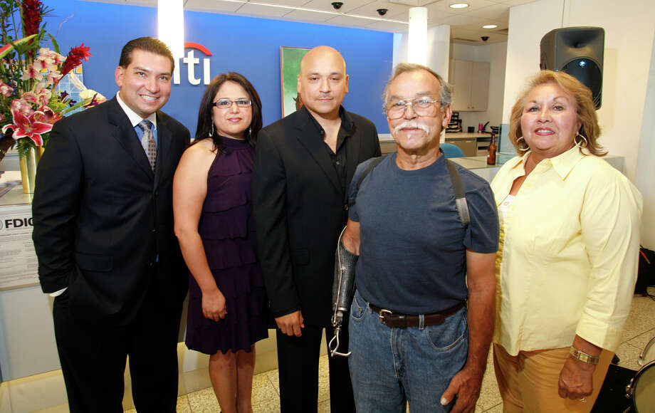 From the left, Peter Cavazos, Lydia Berry, Gabriel Velasquez, Jesse Trevino  and City Coucilwoman Lourdes Galvan at Una Noche de La Gloria, a preview reception for La Gloria art project coming in October to the Guadalupe Cultural and Arts District, held Thursday, June 11, 2009 at CitiBank Las Palmas branch.  (Photo by J. Michael Short) Photo: J. MICHAEL SHORT, Express-News / THE SAN ANTONIO EXPRESS-NEWS/210SA