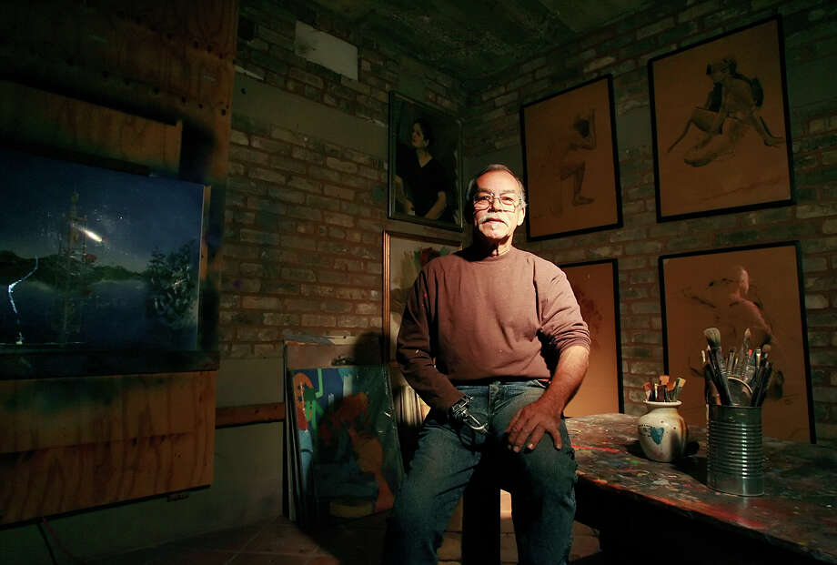 Portrait of artist Jesse Trevino at his studio on the city's West side on December 12, 2008. Also shown to his right is his latest project, a sculpture to be built to honor veterans at Elemendorf Lake. Kin Man Hui/kmhui@express-news.net Photo: KIN MAN HUI, Express-News / SAN ANTONIO EXPRESS-NEWS