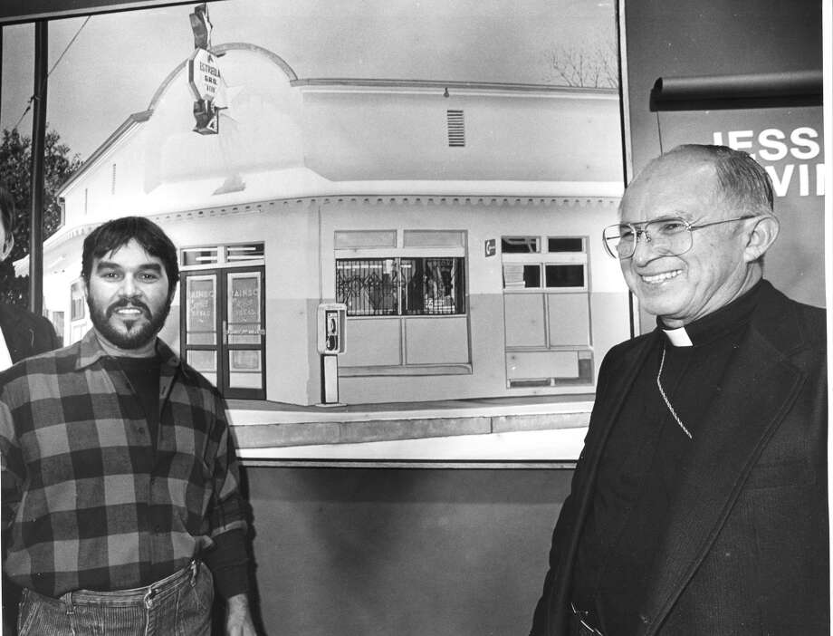 Local Artist Jesse Trevino stands in front of one of his painting with Archbishop Patrick Flores on Sept. 30, 1985 at Dagan Bela Gallery Photo: STEVE KRAUSS, Express-News / SAN ANTONIO EXPRESS NEWS