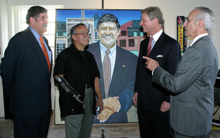 Ricardo Romo  (chair SA Hispanic Chamber of Commerce), Jesse Trevino (artist, honoree), Steve Dufilho (representing sponsor Compass Bank) and Bert Cecconi (commissioned the painting of Romo) were at the Alameda National Center for Latino Arts and Culture on 4/12/2006 for the SA Hispanic Chamber of Commerce honoring of Trevino. Leland A. Outz/Express-News Photo: LELAND A. OUTZ, Express-News / SAN ANTONIO EXPRESS-NEWS