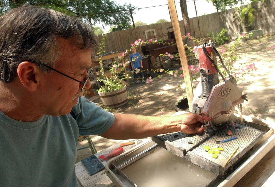 "Artist Jesse Trevino cuts tile for the mural ""Reaching for the Stars"" Sunday April 9, 2006 at his studio.  Trevino was working on the mural with children that have diabetes. PHOTO BY EDWARD A. ORNELAS/STAFF Photo: EDWARD A. ORNELAS, Express-News / SAN ANTONIO EXPRESS-NEWS"
