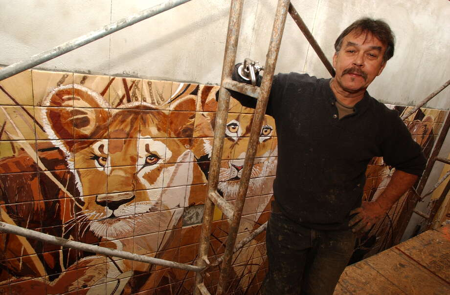 Jesse Trevino, pictured Jan. 28, 2003, is working on a large mural on the wall of Goodwill headquarters.  The mural, made of hand-glazed Italian tiles,  includes images of Trevino and others working on the piece.  (KAREN L. SHAW/STAFF) Photo: Express-News