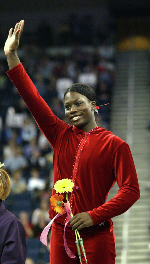 Ashley Miles of Madison and Radiance high schools made four U.S. gymnastics teams and won four NCAA titles at Alabama. In 2006, she was named the best collegiate gymnast. Photo: JOHN BAZEMORE, AP / AP