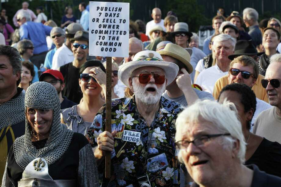 Jerry Siefken, a daily subscriber, participates during a support rally for the paper held earlier this month. Photo: Gerald Herbert / AP