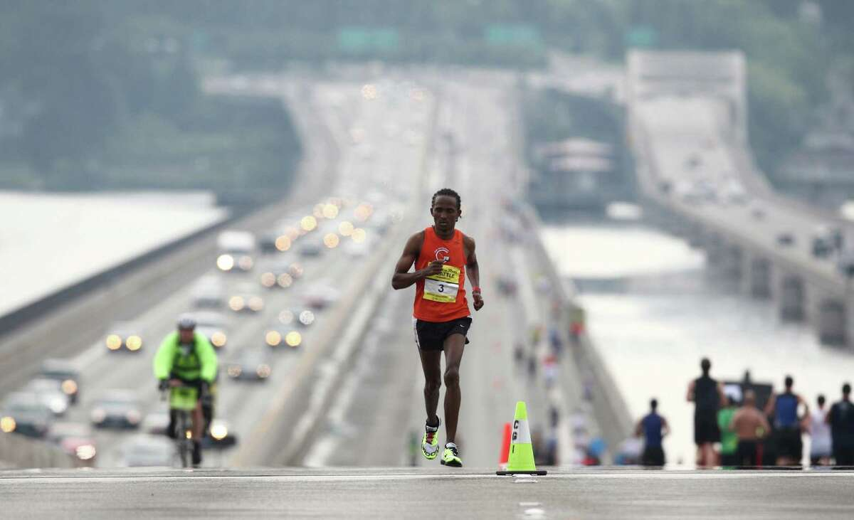 Teshome Kokebe, 30, of Lynnwood leads the pack across the I-90 floating bridge. Kokebe won the men's marathon with a time of 2 hours and 31 minutes.