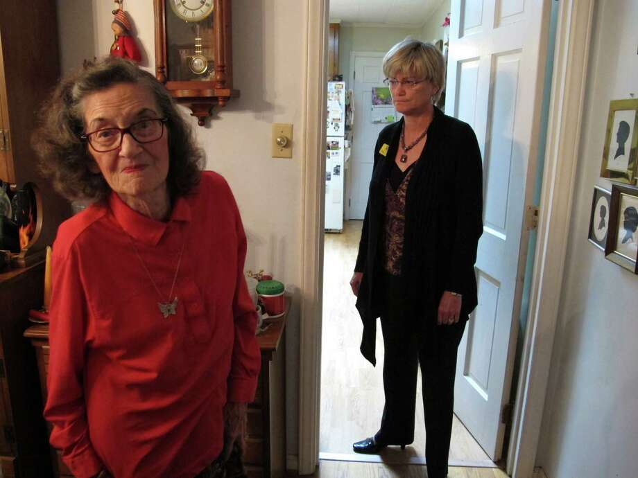 Donna Parker, right, has been forced to keep an eye on her mother, Miriam Parker, after she and her late husband became the victims of a financial scam. Photo: Allen Breed / AP