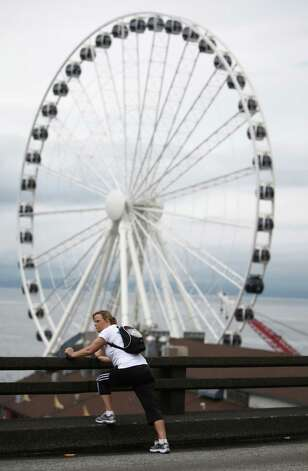 A runner stretches out on the deck of the Alaskan Way Viaduct. Photo: JOSHUA TRUJILLO / SEATTLEPI.COM