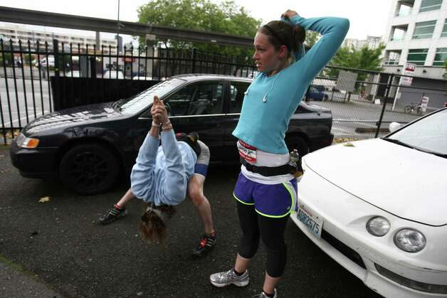 Jeremy Kaufman and Maureen Hagen stretch before running the race. Photo: JOSHUA TRUJILLO / SEATTLEPI.COM