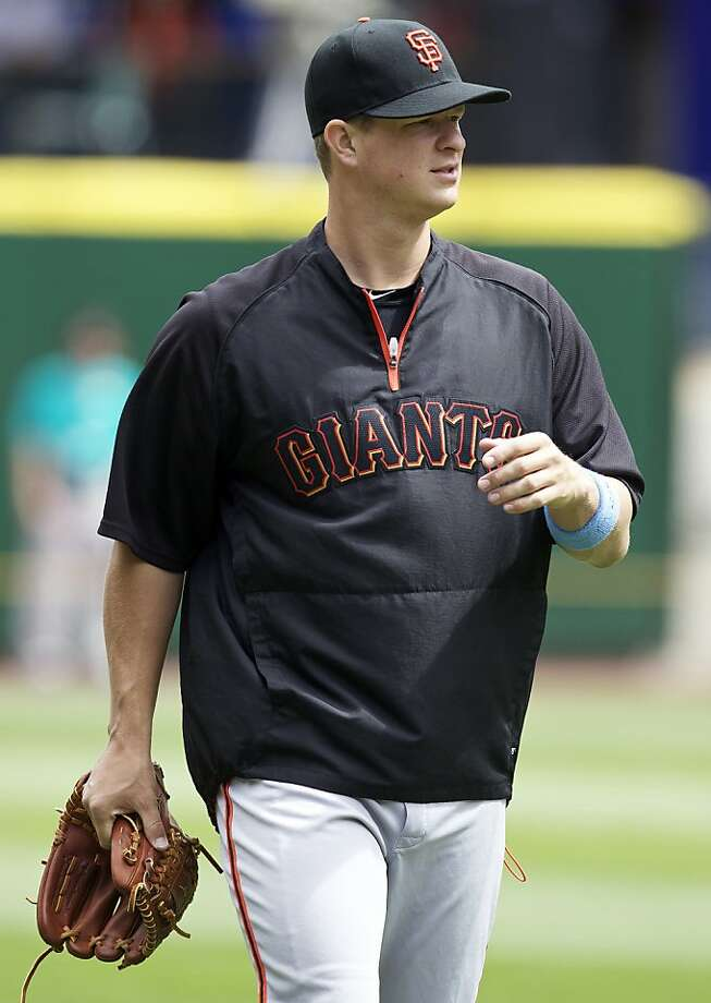 San Francisco Giants starting pitcher Matt Cain walks off the field before a Major League Baseball game against the Seattle Mariners at Safeco Field in Seattle Sunday June 17, 2012. Cain is scheduled to make his first start since pitching a perfect game Monday June 18, 2012 against the Los Angeles Angels of Anaheim. Photo: Stephen Brashear, Associated Press
