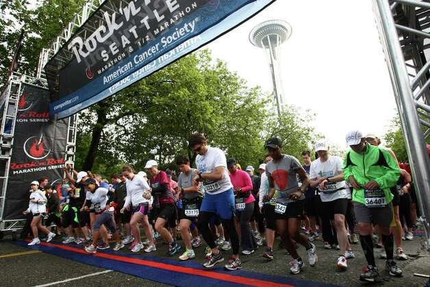 Runners take off from the start. Photo: JOSHUA TRUJILLO / SEATTLEPI.COM