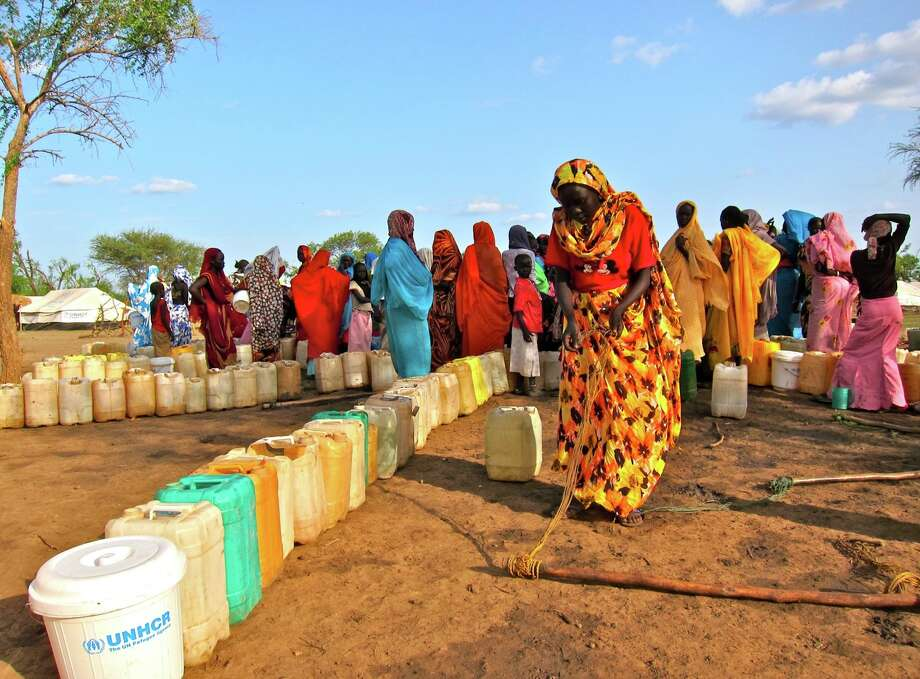 Refugees from the Ingassana Hills in Sudan line up for water in the Jamam refugee camp in South Sudan last week. Fighting caused many to flee their homes. Photo: Alan Boswell / MCT