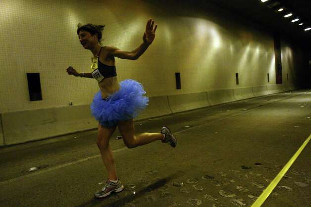 A runner makes her way through the Mount Baker Tunnel. Photo: JOSHUA TRUJILLO / SEATTLEPI.COM