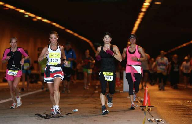 Runners make their way through the Mount Baker Tunnel. Photo: JOSHUA TRUJILLO / SEATTLEPI.COM