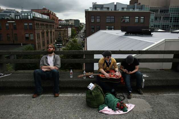 Band members wait to perform on the deck of the Alaskan Way Viaduct. Photo: JOSHUA TRUJILLO / SEATTLEPI.COM