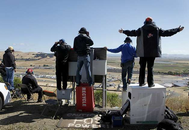 Spotters for NASCAR drivers have a commanding view of the Sonoma Raceway track during practice sessions for the Toyota/Save Mart 350 race in Sonoma, Calif. on Saturday, June 23, 2012. Photo: Paul Chinn, The Chronicle