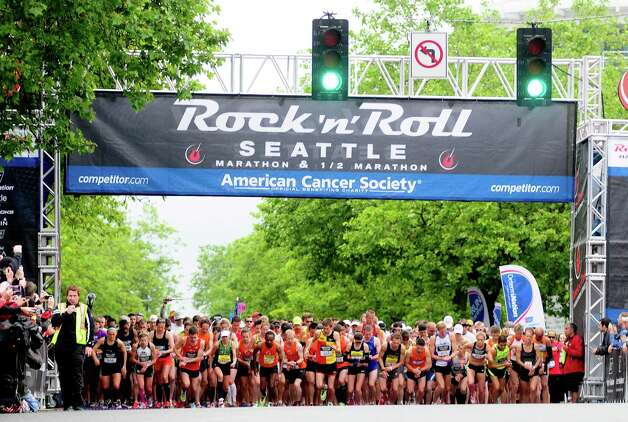 Runners begin the first wave of the race at Denny Way and Broad Street.  The event benefitted the American Cancer Society. Photo: LINDSEY WASSON / SEATTLEPI.COM