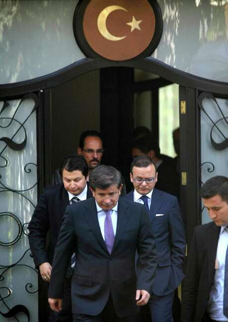 Turkey's Foreign Minister Ahmet Davutogl, center,  leaves a meeting with army generals and other officials to discuss the downing of a military jet that Syria claimed violated its airspace. Photo: ADEM ALTAN / AFP