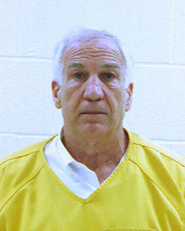 In this booking photo released early Saturday morning June 23, 2012 by the Centre County Correctional Facility in Bellefonte, Pa., former Penn State University assistant football coach Jerry Sandusky is shown. Sandusky was convicted on Friday, June 22, 2012, of sexually assaulting 10 boys over 15 years Friday, accusations that had sent shock waves through the college campus known as Happy Valley and led to the firing of Penn State's beloved Hall of Fame coach, Joe Paterno.. (AP Photo/Centre County Correctional Facility) Photo: Anonymous