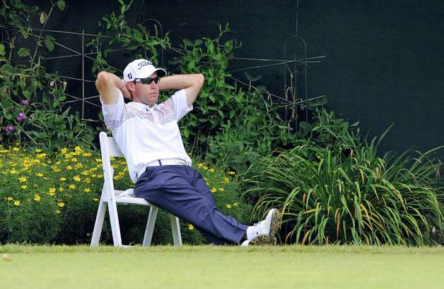 Brian Davis takes a break on the tenth hole of the third round of the Travelers Championship golf tournament in Cromwell, Conn., Saturday, June 23, 2012. (AP Photo/Fred Beckham) Photo: Fred Beckham, Associated Press / FR153656 AP