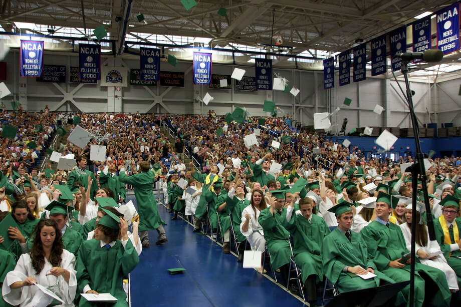 Hats are tossed in the air at the end of the New Milford High School Class of 2012 exercises which took place on Saturday, June 23, 2012 , at The O'Neill Center at WCSU in Danbury, CT. Photo: News Times Contributed