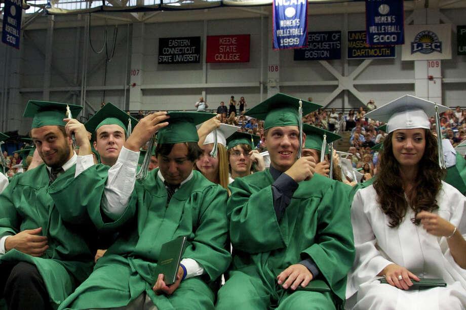(left to right) Matthew Arnold, Jason Asman, Theodore Augeri, and Krista Balestaci turn the tassels at the end of the New Milford High School Class of 2012 exercises which took place on Saturday, June 23, 2012 , at The O'Neill Center at WCSU in Danbury, CT. Photo: News Times Contributed