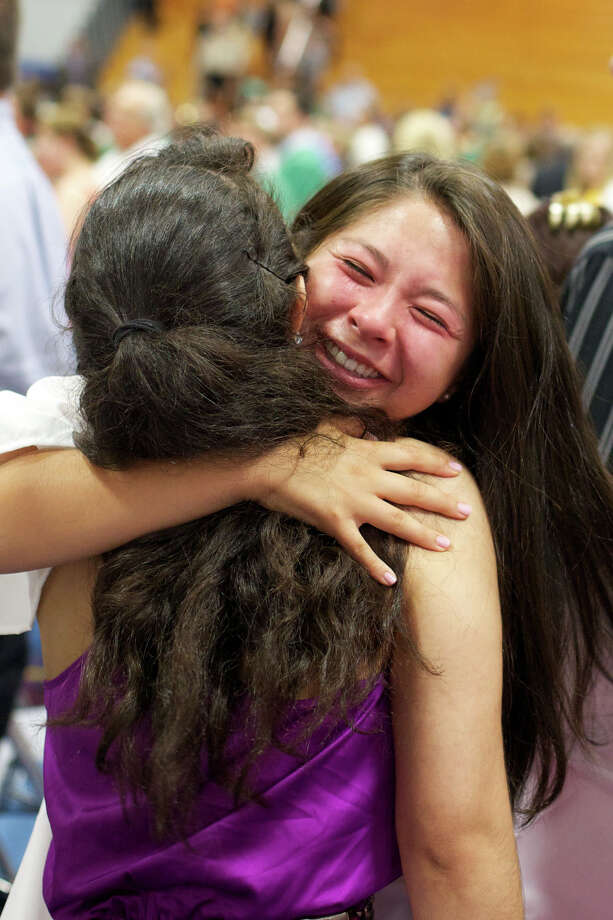An emotional Laurel Byrnes, Senior Class President, gives one of her friends a hug after the New Milford High School Class of 2012 exercises which took place on Saturday, June 23, 2012 , at The O'Neill Center at WCSU in Danbury, CT. Photo: News Times Contributed