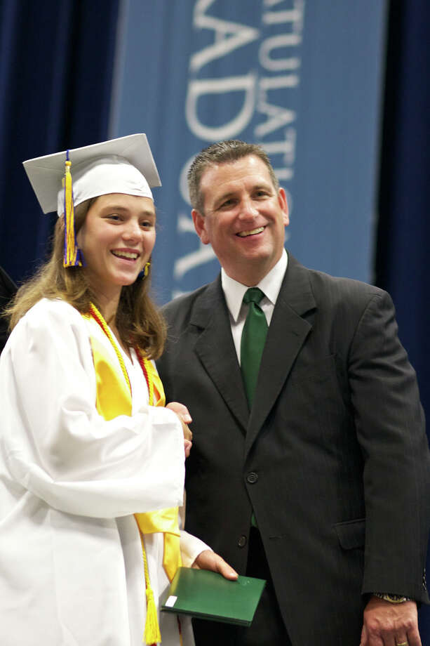 Tara Larkin shakes hands with Principal and Master of Ceremonies Mr. Greg Shugrue during the New Milford High School Class of 2012 exercises which took place on Saturday, June 23, 2012 , at The O'Neill Center at WCSU in Danbury, CT.  Tara will be leaving for the United States Coast Guard Academy in New London tomorrow (Sunday, June 24, 2012). Photo: News Times Contributed