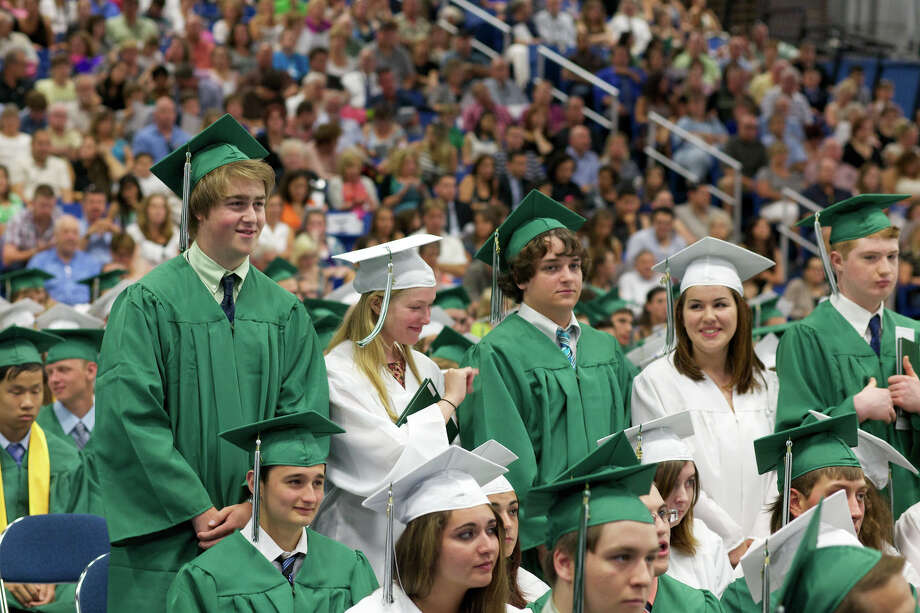 (from left to right) Garner Huckvale, Jacqueline Hopkins, Joshua Hook, Maria Hinz, and Timothy Heydenburg stand with diploma's in hand in front of a very large crowd during the New Milford High School Class of 2012 exercises which took place on Saturday, June 23, 2012 , at The O'Neill Center at WCSU in Danbury, CT. Photo: News Times Contributed