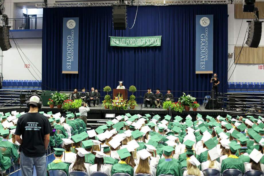 On the stage the Valedictorian, Annie Mao, speaks to her fellow graduates during the New Milford High School Class of 2012 exercises which took place on Saturday, June 23, 2012 , at The O'Neill Center at WCSU in Danbury, CT. Photo: News Times Contributed