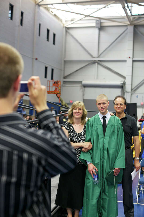 (left to right) Patricia D'Ascoli, her son James D'Ascoli, and  dad Raphael D'Ascoli, pose for a picture after the New Milford High School Class of 2012 exercises which took place on Saturday, June 23, 2012 , at The O'Neill Center at WCSU in Danbury, CT. Photo: News Times Contributed