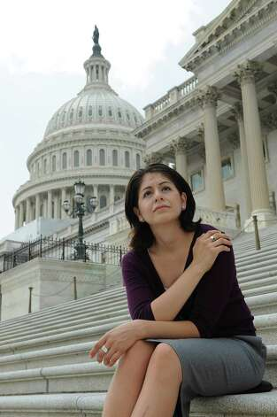 "Julieta Garibay sits on the steps of the United States Capitol in Washington DC. She is a poster child for Obama's new immigration policy: Her parents brought her to the U.S. when she was 12 and she's lived here 20 years. She has bachelors and a masters degree in nursing from the University of Texas at Austin. But Garibay is 31 years old, and the plans announced by the Obama administration cut off eligibility at age 30. Meaning that Garibay, who dreams of being a military nurse, will have little option but to continue working as volunteer and a babysitter while many of the undocumented immigrants she stood with on the cover of TIME likely will get a chance to work in their chosen fields. ""It's a little disappointing,"" she said, ""but it does not take away from this huge victory.""  Photo by Mary F. Calvert for The Houston Chronicle Photo: MARY F. CALVERT, For The Chronicle / © 2012 MARY F. CALVERT/HOUSTON CHRONICLE"