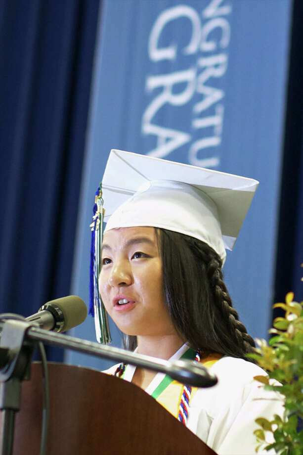 Valedictorian, Ms. Annie Mao, happily ends her presentation toward her fellow graduates.   Ms. Mao will be attending Johns Hopkins University for Biomedical Engineering, with a minor in French, in the fall.  The New Milford High School Class of 2012 (the one hundred and fifteenth graduation exercises) took place on Saturday, June 23, 2012 , at The O'Neill Center at WCSU in Danbury, CT. Photo: News Times Contributed