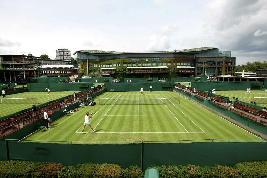 "For a sport whose original name was ""lawn tennis,"" the grass courts at Wimbledon that will be featured during the next fortnight may be the signature surface. Photo: Clive Rose / 2012 Getty Images"