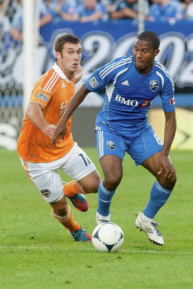 Patrice Bernier controls the ball against Will Bruin. Photo: Francois Laplante, Getty Images / 2012 Getty Images