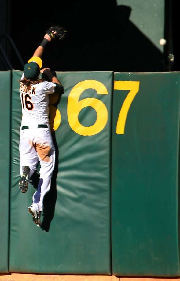 Oakland Athletics Josh Reddick watches, San Francisco Giants Brandon Belt  two run homer go over the right field fence in the 5th inning of their MLB baseball game Saturday June 23, 2012 at the Oakland Coliseum, in Oakland California. Photo: Lance Iversen, The Chronicle
