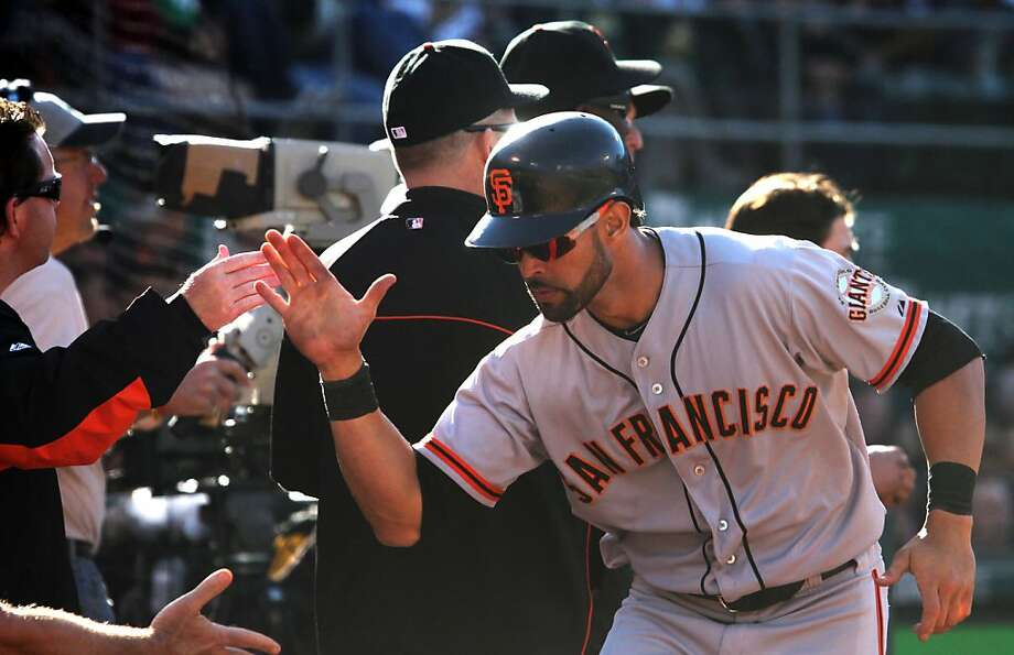 San Francisco Giants Angel Pagan is greeted at the dougout in the 6th inning after scoring against the Oakland Athletics Saturday June 23, 2012 at the Oakland Coliseum, in Oakland California. Photo: Lance Iversen, The Chronicle
