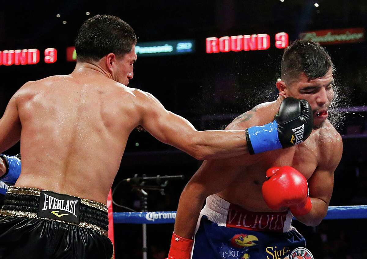 Victor Ortiz (right) takes a hard punch from Josesito Lopez during the ninth round of their WBC welterweight bout. Ortiz won in a stunning upset.