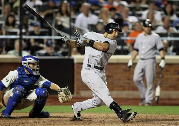 NEW YORK, NY - JUNE 23:  Raul Ibanez #27 of the New York Yankees hits a three run homer in the seventh inning as Josh Thole #30 of the New York Mets catches on June 23, 2012 during interleague play at Citi Field in the Flushing neighborhood of the Queens borough of New York City.  (Photo by Elsa/Getty Images) Photo: Elsa